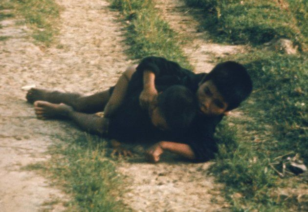Vietnamese children about to be shot by US Army soldiers during pursuit of Vietcong militia, as per order...