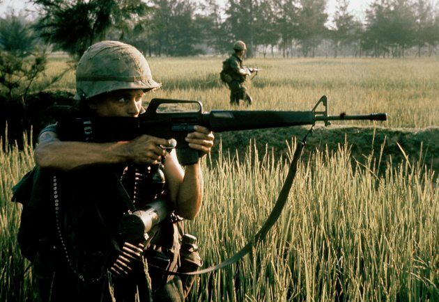 An American soldier firing his M16 rifle during the My Lai massacre on March 16, 1968 in My Lai, South...