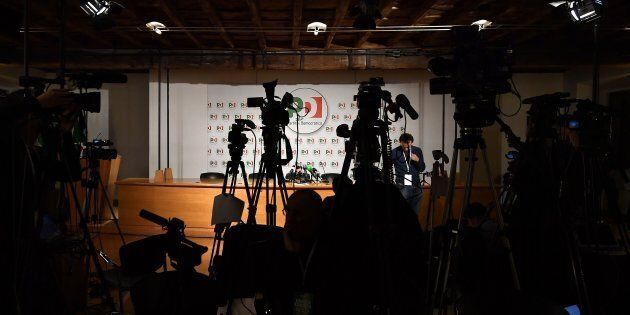 Journalists wait at the headquarters of Italy's Democratic Party (PD) before the closure of the polling...
