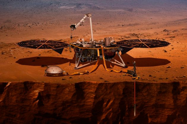 This illustration made available by NASA in 2018 shows the InSight lander drilling into Mars. InSight,...
