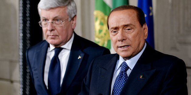 Former Prime Minister Silvio Berlusconi (R) flanked by former minister Paolo Romani (L) speaks after...