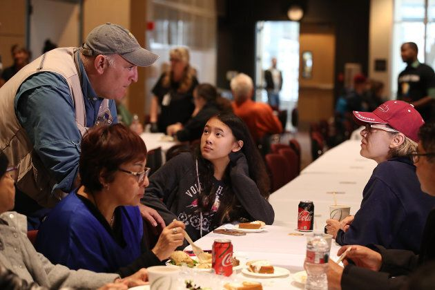 CHICO, CA - NOVEMBER 22: Celebrity chef Jose Andres (L) talks with evacuees during a community Thanksgiving...