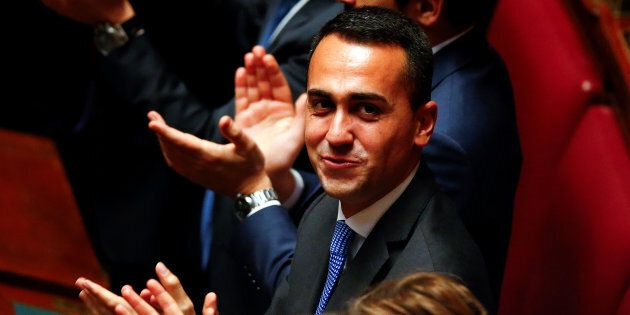 Five Stars Movement (M5S) leader Luigi Di Maio applauses the new Chamber of Deputies president Roberto...