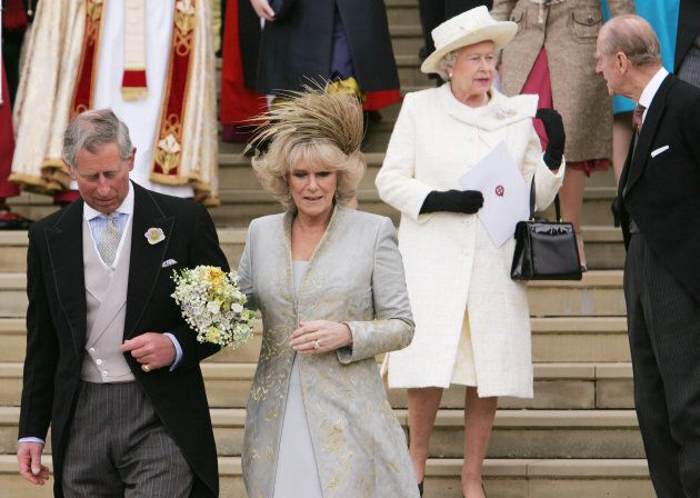 Britain's Prince Charles and the Duchess of Cornwall leave St. George's Chapel followed by Queen Elizabeth...