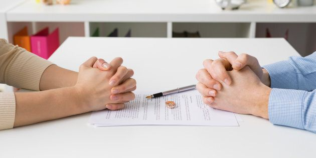 Couple going through divorce signing