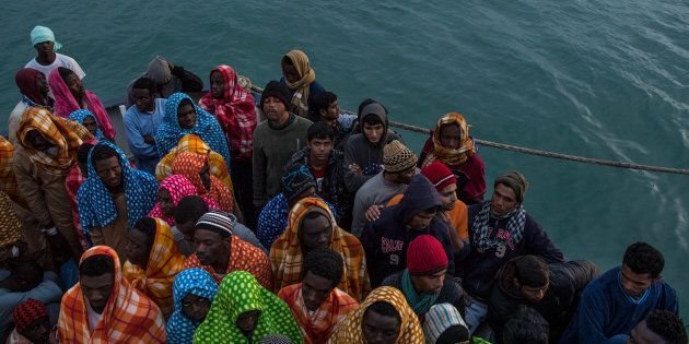 POZZALLO, ITALY - FEBRUARY 19: Refugees and migrants wait on deck of the Spanish NGO Proactiva Open Arms...