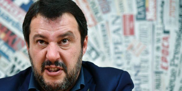 TOPSHOT - Leader of the far-right League (Lega Nord) party, Matteo Salvini reacts during a meeting with...