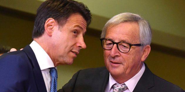 European Commission President Jean-Claude Juncker, right, speaks with Italian Prime Minister Giuseppe...