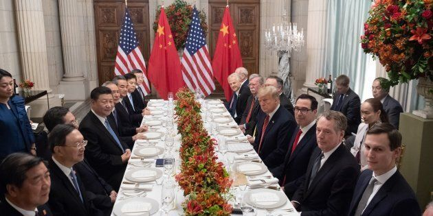 US President Donald Trump (C-R) and China's President Xi Jinping (C-L) along with members of their delegations,...