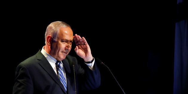 Israeli Prime Minister Benjamin Netanyahu gestures during a speech at a regional development conference...