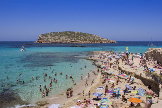 IBIZA, SPAIN - JUNE 26: Many tourists at Cala Conta beach on June 26, 2017, in San Antonio, in Ibiza...