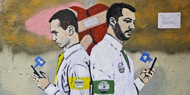 A mural painted on a building shows Italian Deputy Premiers 5-Star Movement's Luigi Di Maio, left, and...
