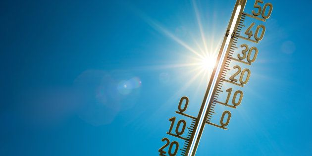 Thermometer with bright sun and blue