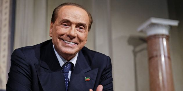 Forza Italia leader Silvio Berlusconi smiles as League party leader Matteo Salvini (not seen) speaks...