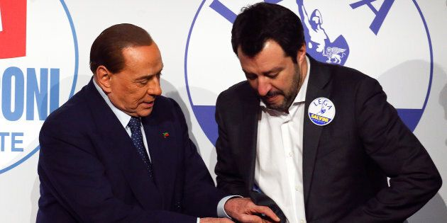 Forza Italia leader Silvio Berlusconi gestures next to Northern League leader Matteo Salvini prior to...