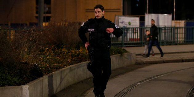 Police officer secures a street and the surrounding area after a shooting in Strasbourg, France, December...