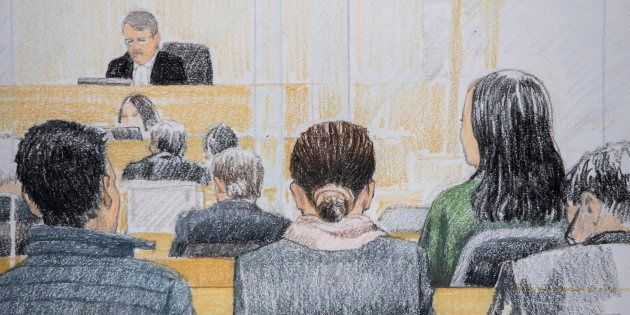 In this courtroom sketch, Meng Wanzhou, back right in green, the chief financial officer of Huawei Technologies,...
