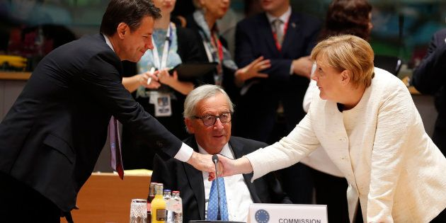 German Chancellor Angela Merkel, right, shakes hands with Italian Prime Minister Giuseppe Conte, left,...