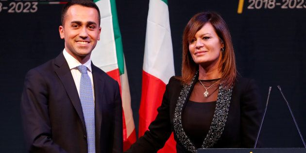 5-Star Movement leader Luigi Di Maio shakes hands with Paola Giannetakis, who would be Interior Minister...