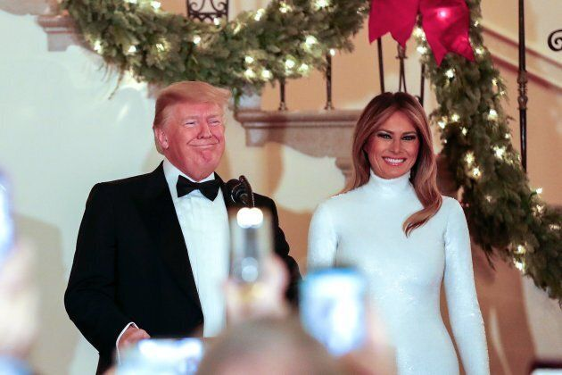 US President Donald Trump and First Lady Melania Trump (R) greet guests during the Congressional Ball...