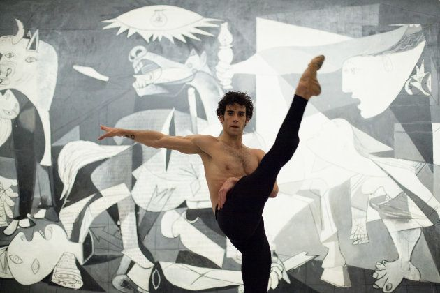MADRID, SPAIN - APRIL 22: Dancer Josue Ullate performes a 'Quiebro' next to Pablo Picasso's painting...