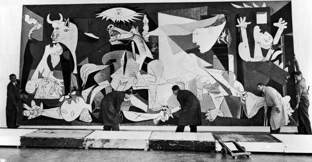 Guernica, perhaps the most famous painting by Pablo Picasso, being hung in the Municipal Museum in Amsterdam...