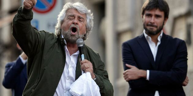 Five-Star Movement leader Beppe Grillo, left, is flanked by MP Alessandro Di Battista as he addresses...