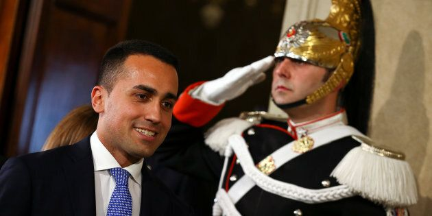 Anti-establishment 5-Star Movement leader Luigi Di Maio leaves after the meeting with the Italian President...