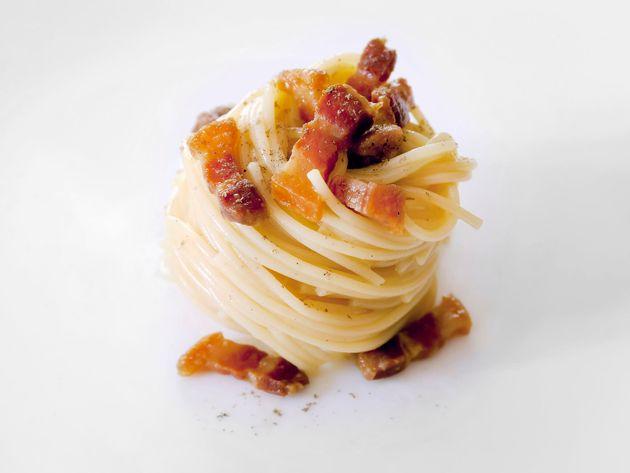 72512037 - spaghetti carborara. ingredients: pasta, eggs, bacon, pecorino cheese, salt and pepper. ready...