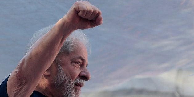 Former Brazilian President Luiz Inacio Lula da Silva attends a protest in front of the metallurgic trade...