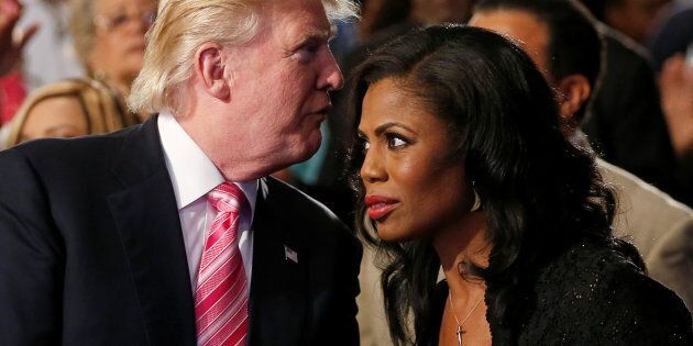 Republican presidential nominee Donald Trump and Omarosa Manigault (R) attend a church service, in Detroit,...