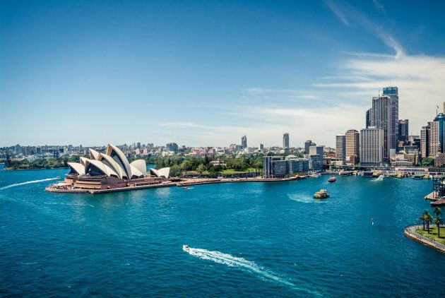 Sydney Opera House and Circular quay, ferry terminus, from the harbour