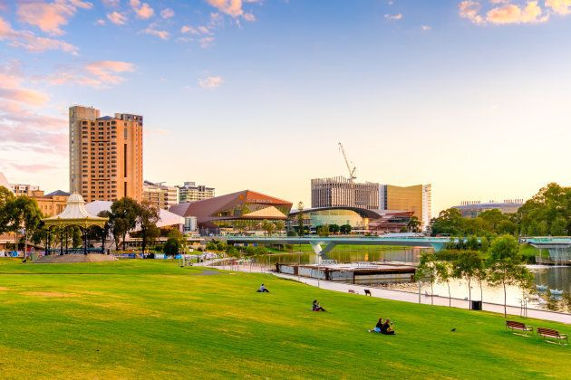 Adelaide: Adelaide city skyline with Torrens river foot bridge at sunset viewed from King William street...