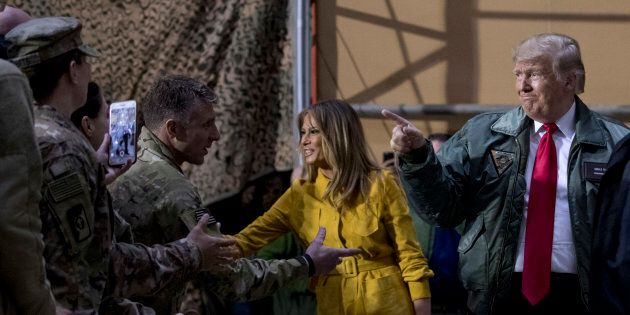 President Donald Trump and first lady Melania Trump greet members of the military at a hanger rally at...