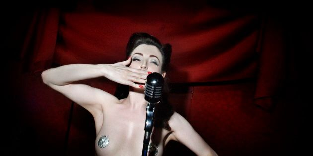 U.K. Burlesque performer Polly Rae waves to the public after the show at the Apollo Dancing club in Milan,...