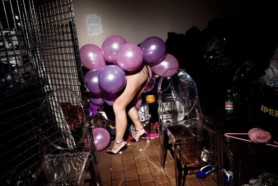 Scarlet Martini, from Italy, gets ready for the balls show backstage at the Micca Club, Rome. April,