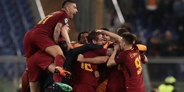 AS Roma's players celebrate after winning the UEFA Champions League quarter-final second leg football...