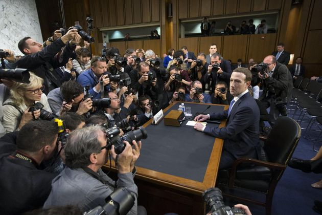 epaselect epa06660088 CEO of Facebook Mark Zuckerberg (R) takes his seat to testify before the Senate...