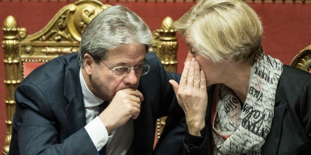 ROME, ITALY - DECEMBER 14: Italian Prime Minister Paolo Gentiloni and Minister of Defense Roberta Pinotti...