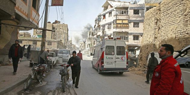 Smoke rises during evacuation in the besieged town of Douma, Eastern Ghouta, in Damascus, Syria March...