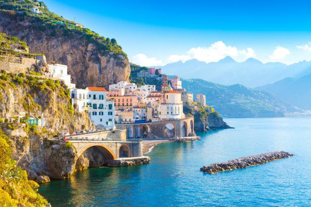 Morning view of Amalfi cityscape on coast line of mediterranean sea,