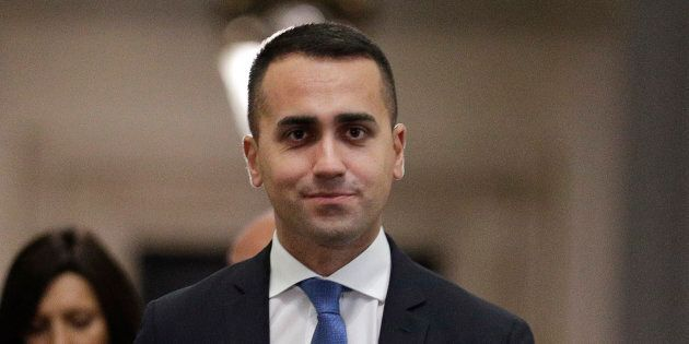 Italian deputy Premier and Labor Minister Luigi Di Maio arrives to talk to reporters at the end of a...