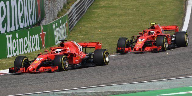 Ferrari's German driver Sebastian Vettel takes a corner during ahead of teammate Finnish driver Kimi...