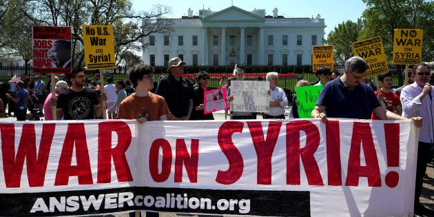 Demonstrators protest after the missile strikes on Syria, outside the White House in Washington, U.S.,...