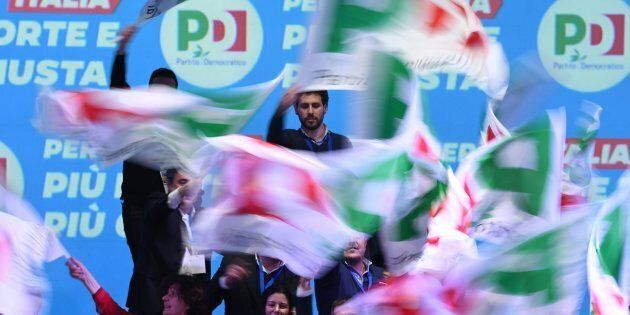 Supporters waves flags as former prime minister and head of the centre-left Democratic Party (PD) speaks...