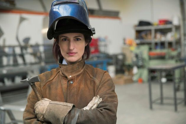 Portrait of serious female welder in manufacturing