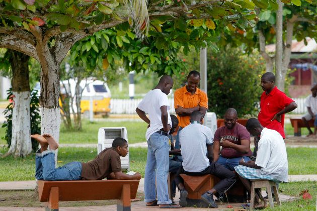 Haitian immigrants play dominoes at the town square in Inapari, Peru's border with Brazil, February 2,...