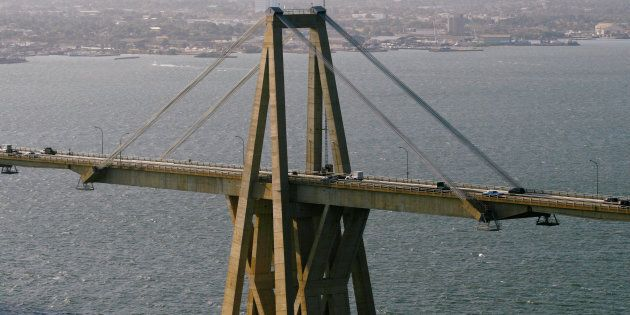 Cars drive along General Rafael Urdaneta Bridge, designed by Riccardo Morandi, in Maracaibo, Venezuela...