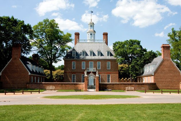 The Governor's Palace in Colonial Williamsburg, Virginia. A brick Colonial house with a courtyard, and...