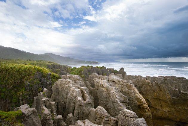 Pancake Rocks in Paparoa National Park under overcast sky, Punakaiki, South Island, New